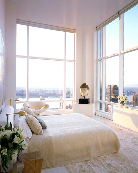 bedroom, white floor, white wall, white rug, white low cabinet, large glass window