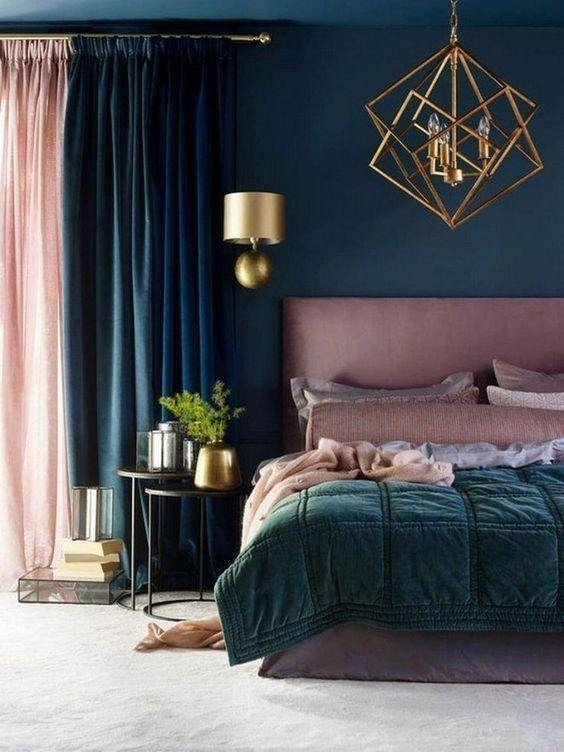 bedroom, white rug, pink headboard, green blanket, green wall, golden pendant, golden geometric pendant