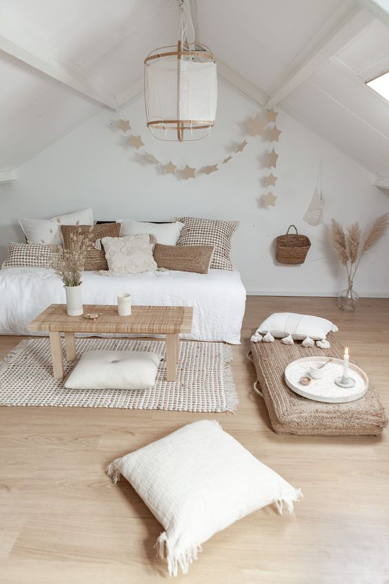bedroom, wooden floor, white wall, white ceiling, white pendant, white bedcover, rattan wooden coffee table, rattan pillow, woven rug