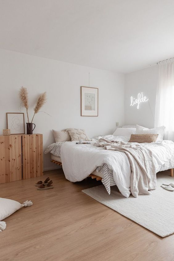 bedroom, wooden floor, white wall, wooden bed frame, white rug, wooden cabinet,