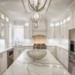 Corner Kitchen Sink Cabinet Pendant Lamps White Marble Backsplash White Cabinets Refrigerator White Marble Countertops Oven Glass Shelves Windows Drawers