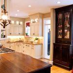 Corner Kitchen Sink Cabinet Windows Red Valance Classic Pendant Lamp Dark Brown Cupboard Door Granite Countertop Beige Backsplash Recessed Lighting Stovetop