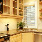 Corner Kitchen Sink Cabinet Windows Shade Open Shelves Glass Cabinet Doors Granite Countertop Stovetop Double Sink Dishwasher Oven Backsplash Drawers