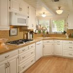Corner Kitchen Sink Cabinet Wooden Floor Windows Pendant Lamp White Oven White Dishwasher Stovetop Brown Countertop Tiles Brown Backsplash White Beams Cans