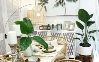 dining room, wooden floor, wooden dining table, rattan table, white wall, white cabinet, white pot