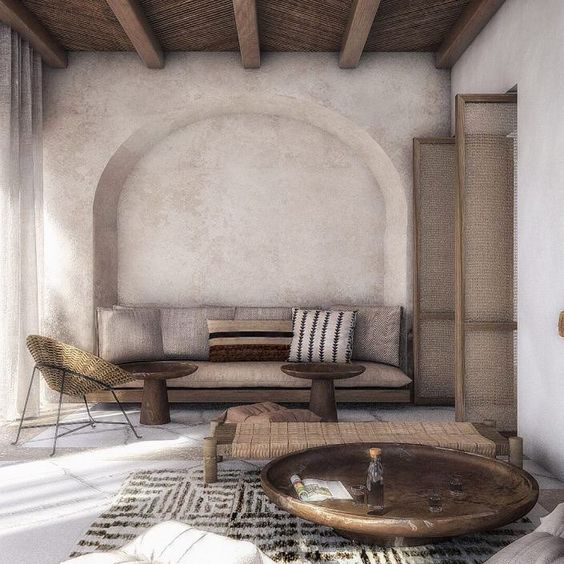 living room, cream wall, seamless floor, rattan wooden beam ceiling, nook on the wall, rug, round coffee tables, rattan chair, woven bench, sofa, rattan door