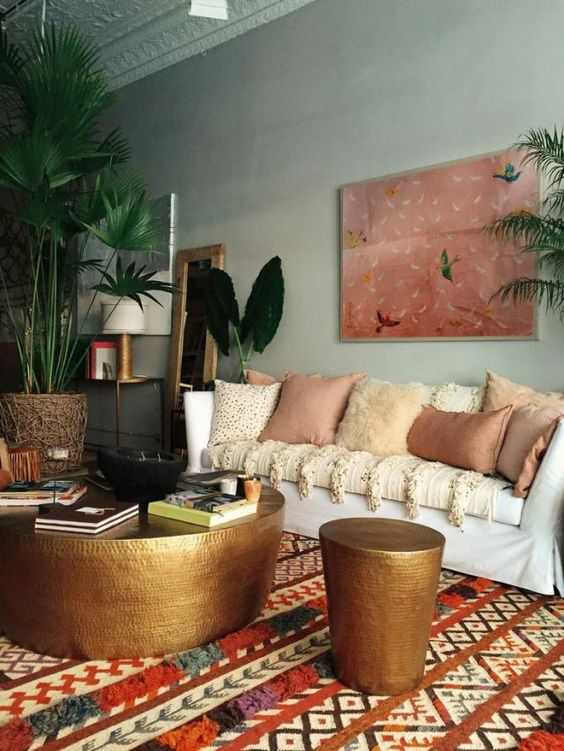 living room, green wall, pattern rug, white sofa, golden coffee table, golden stool, plants