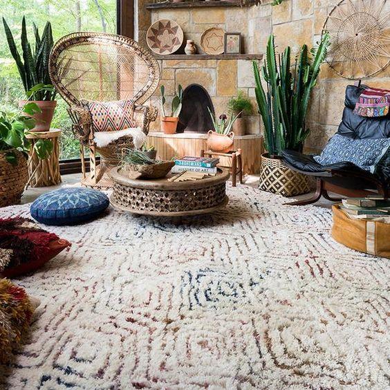living room, rug, brown stone wall, ratta chair, rattan coffee table, dark blue chair