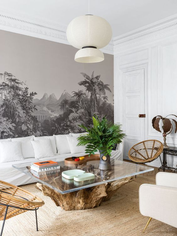 living room, white wall, rattan rug, rattan chair, white sofa, white chair, wooden table with glass top, white pendant