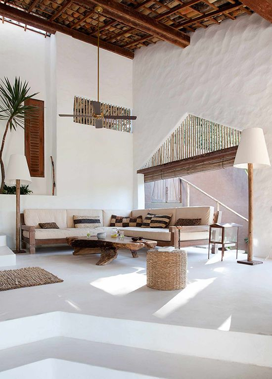 living room, white wall, white seamless floor, wooden sofa with cream cushion, wooden coffee table, rattan stool, naked ceiling, white wooden lamp