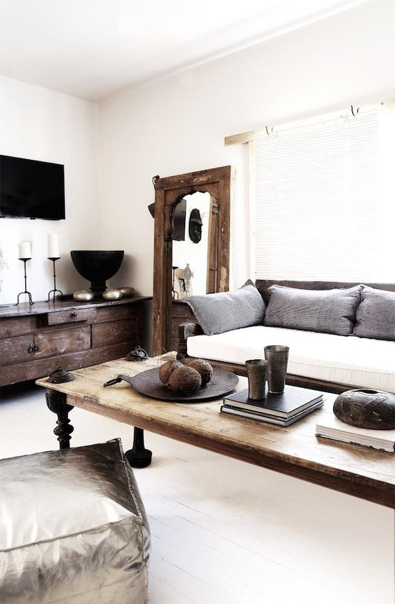 living room, white wooden floor, white wal, wooden sofa with white cushion, wooden coffee table, wooden cabinet, wooden framed mirror