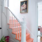 Peach Painted Stairs, White Wooden Rail, White Wall, Wooden Floor, White Rug