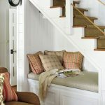 Seats Under The Stairs, White Vertical Plank, White Wooden Bench, Brown Cushion, Pillows, Wooden Floor, Brown Sofa