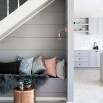 Seats Under The Stairs, Wooden Floor, Grey Wall Plank, White Stairs, Grey Built In Bench, Golden Ottoman, Golden Sconce