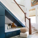 Seats Under The Stairs, Wooden Floor, White Wall, White Stairs, Bue Built In Bench And Storage, Blue Cushion, Blue Rug