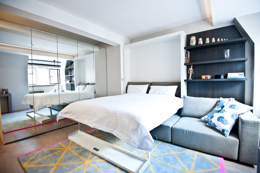 small room design ideas folded bed white bedding pillows open shelves colorful rug blue sofa mirrored wardrobe wooden floor windows