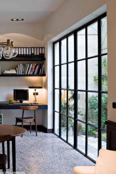 study, large glass windows, white wall, black built in table, wooden chair, floating shelves