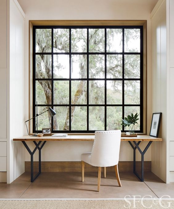 study, white wall, wooden floor, black metal framed window, white chair, woden table with black metal legs