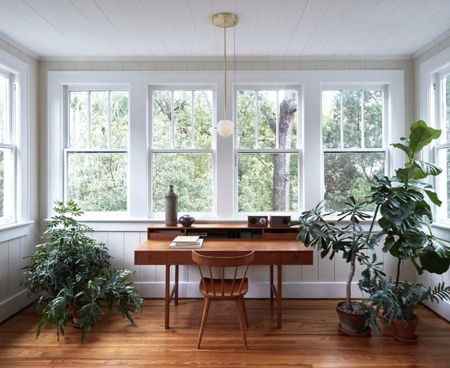 study, wooden floor, white plank wall and ceiling, white pendant, wooden table with drawers, wooden chair, plants, window