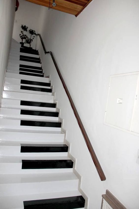white black piano stairs, white wall, wall rail