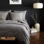 White Lantern Pendant On The Side, Dark Grey Wall, Grey Bed Linen