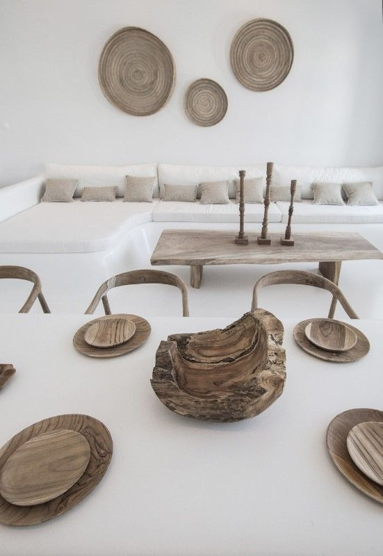 white living room, white wall, white built in sofa, white cushion, white dining table, wooden chairs, wooden coffee table