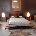 Wooden Box Platform With White Linen, Wooden Headboard, Grey Seamles Floor, Dark Wall
