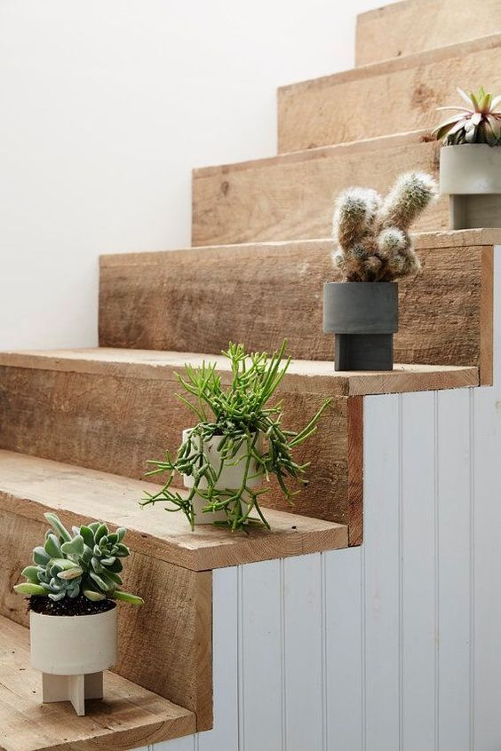 wooden coated stairs, white plank wall