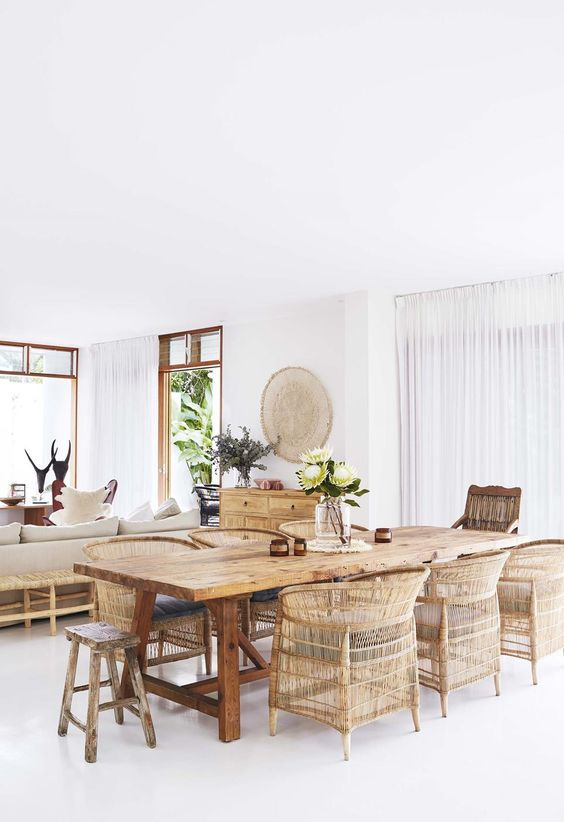 wooden dining table, rattan chairs, wooden chair, woden stool, white wall, white floor, white curtain, wooden cabinet