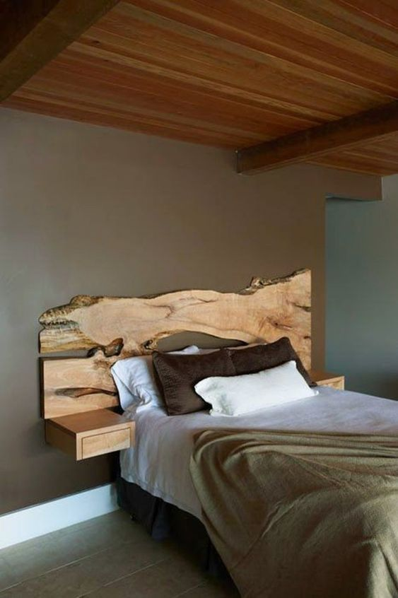 wooden platform, floating side table, patterned slab headboard, wooden ceiling, grey wall