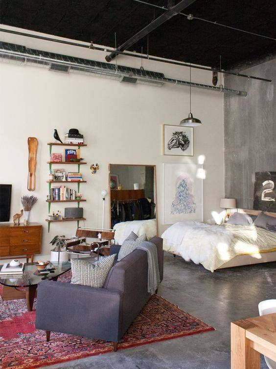apartment, grey floor, grey wall, white wall, white bed, grey sofa, red rug, wooden cabinet, silver pendant