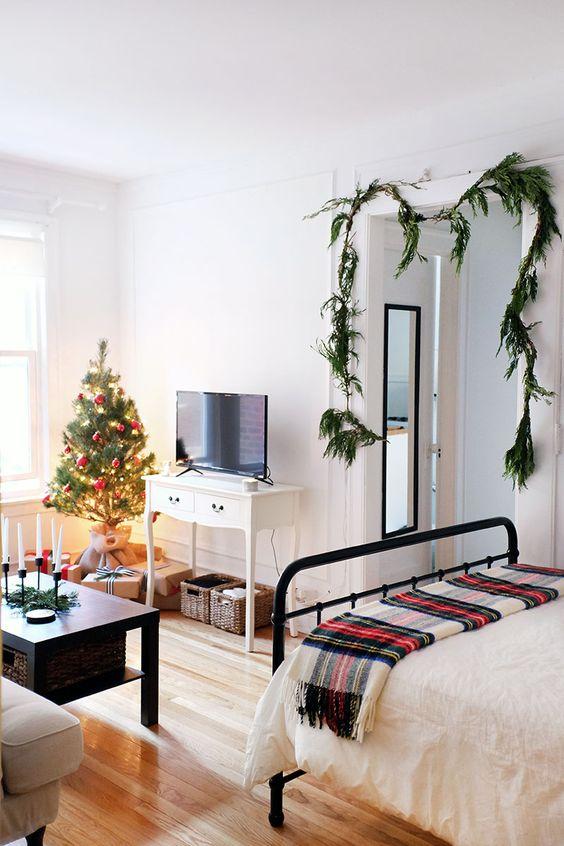 apartment, wooden floor, white wall, white bedding, black metal platform, black coffee table, white classic console, grey sofa