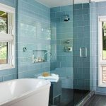 Bahtroom, Blue Wall Tiles, Shower With Glass Partition, Dark Wooden Floor, White Tub, Glass Windows