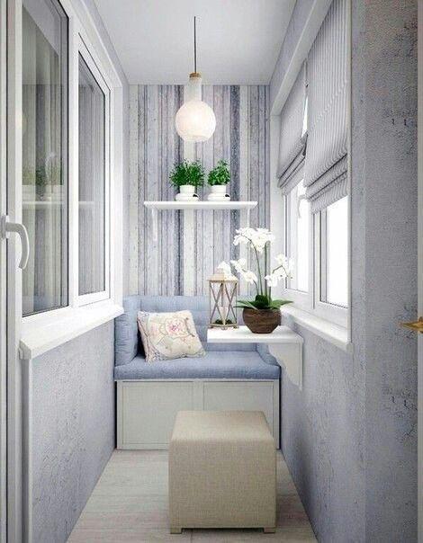 balcony, wooden floor, white bench, light blue cushion with back, white globe pendant, white roman curtain, brown cube ottoman