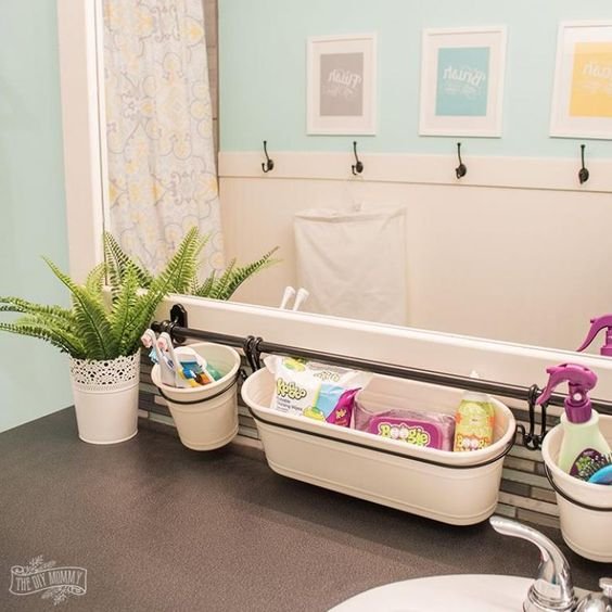 bathroom, grey floor, white bath tub, blue wall, storage on the rod
