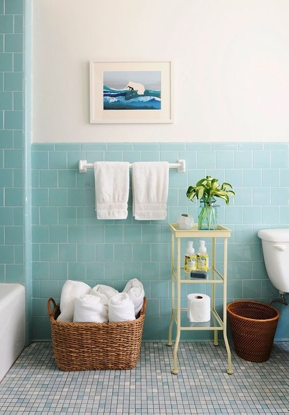 bathroom, grey tiny floor tiles, white wall, blue wall tiles, white tub, white toilet