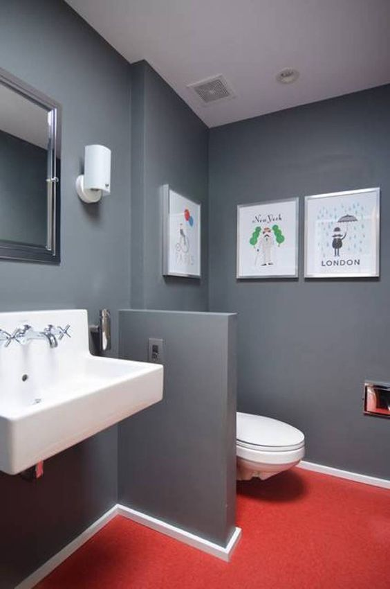 bathroom, grey wall, white toilet, white sink, mirror, red floor