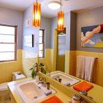 Bathroom, Hexagonal Floor Tiles, Yellow Square Wall Tiles, Yellow Vanity, White Sink, Orange Pendant, Grey Wall, Large Mirror