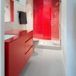 Bathroom, Light Grey Floor, White Wall, Red Floating Cabinet, Red Accent Wall, Glass Partition, White Toilet