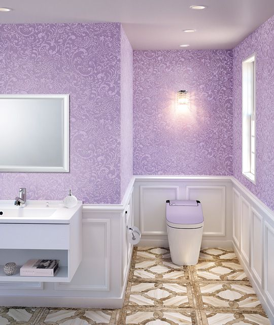 bathroom, pattern brown floor tiles, purple patterned wall, white wainscoting, white toilet, purple lid, white floating cabinet, mirror
