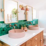 Bathroom, Patterned Floor Tiles, White Wall, Wooden Vanity White Top, Pink Round Sink, Green Backsplash Wall, White Wall, Golden Framed Mirror, Golden Faucets