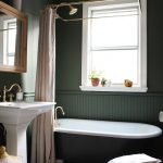 Bathroom, White Floor, Green Wainscoting, Green Wall, White Framed Window, White Sink, Red Rug, Golden Curtain Rail, Green Tub