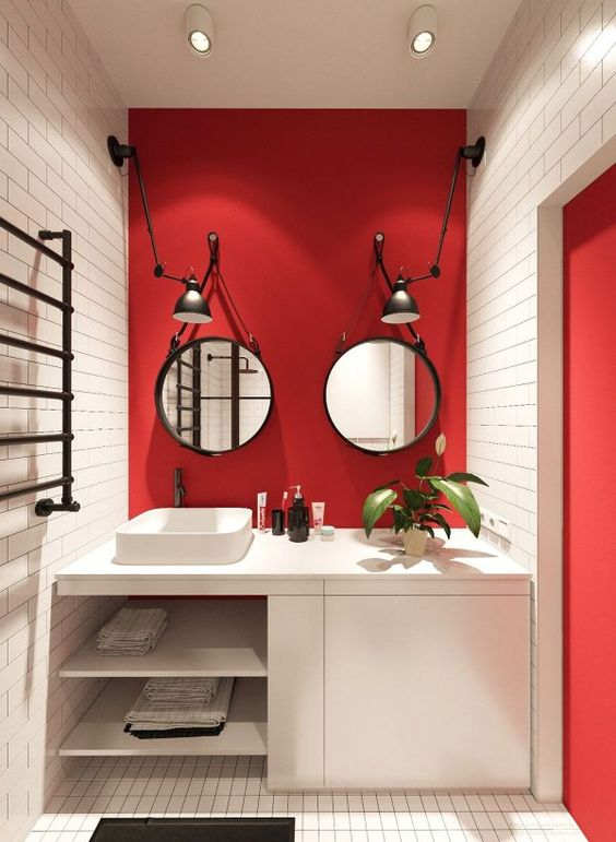 bathroom, white subway wall tiles, red accent wall, red side, white vanity, white sink, two mirrors