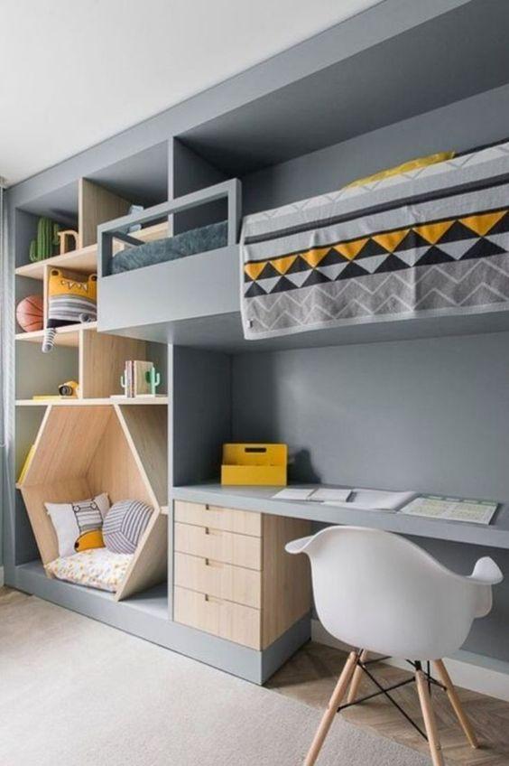 bedroom, wooden floor, grey rug, grey wall, floating built in bed, built in shelves, sitting nook, built in study