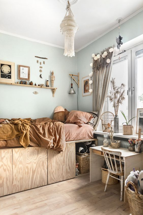 bedroom, wooden floor, light blue wall, wooden bed platform with storage, terracotta bed, floating shelves, small study table. large glass windows