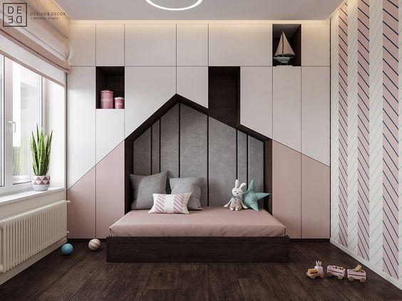 bedroom, wooden floor, white pink built in cupboard, wall nook, wooden bed with pink bedding,