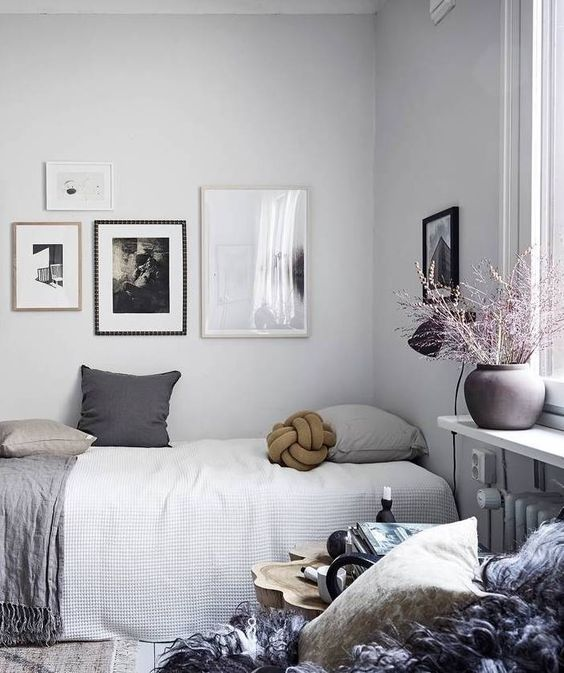 bedroom, wooden floor, white wall, small bed, shelves on window bay, side table