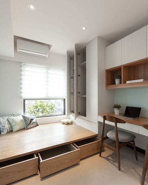 bedroom, wooden floor, white wall, white built in cupboard, white floating cabinet, wooden floating shelves, floating table, wooden chair