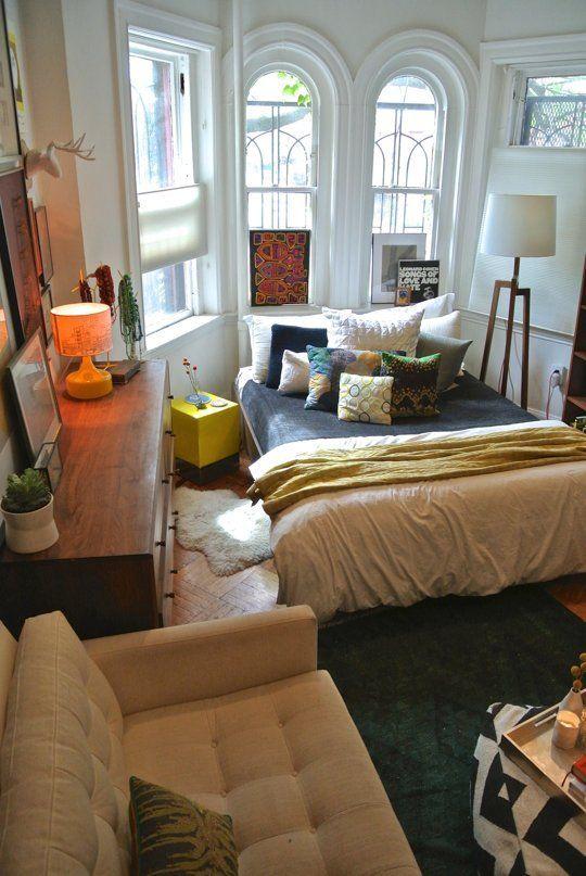 bedroom, wooden floor, white wall, white framed window, black and white bedrom, white floor lamp, white sofa, black white coffee table, wooden cabinet