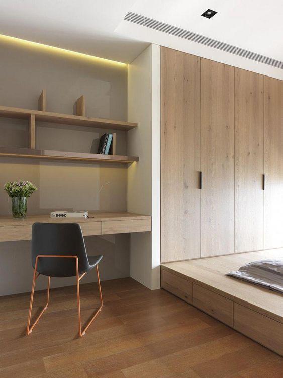 bedroom, wooden floor, wooden platform, wooden built in cupboard, wooden floating shelves, wooden floating table